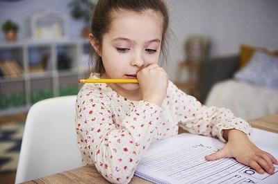 focused-girl-doing-her-homework-at-home.jpg